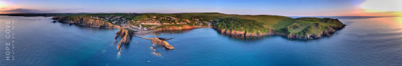 Aerial panoramic photo of Hope Cove, South Devon, taken at sunset